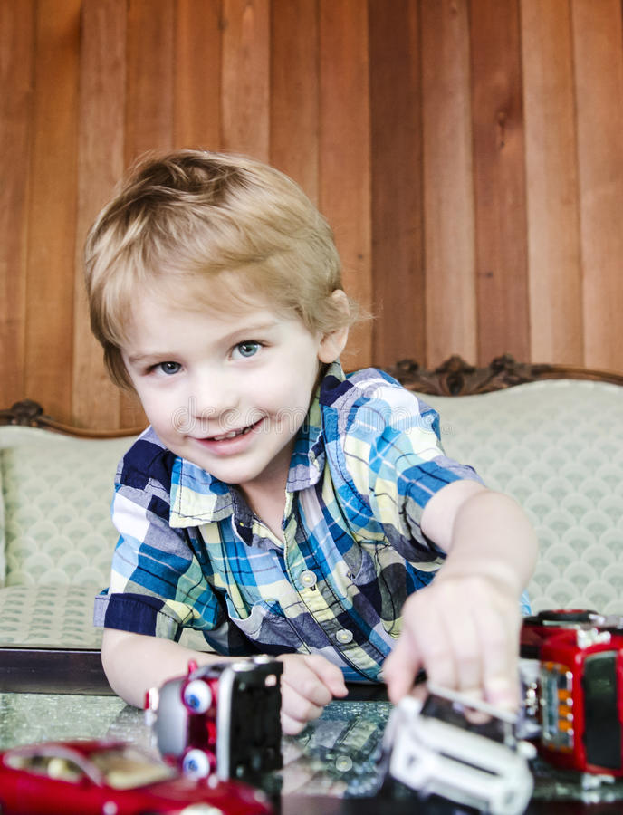 Boy playing with toy cars royalty free stock photo