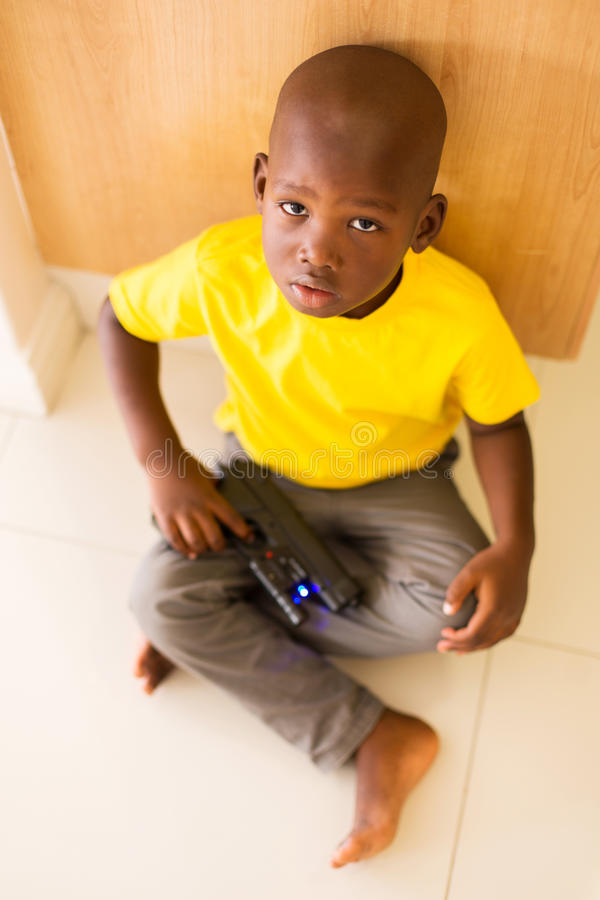 Boy playing toy gun. Top view of little boy playing with toy gun stock images