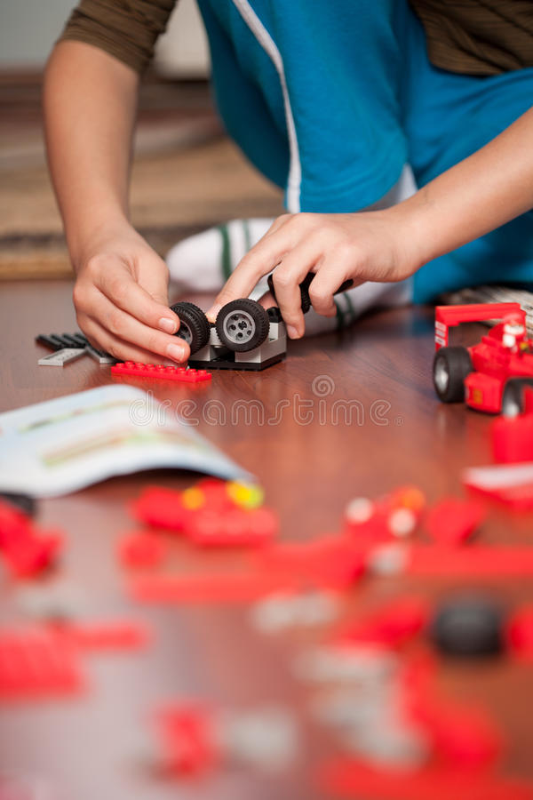 Download Boy playing with toys stock photo. Image of schoolboy - 18058366