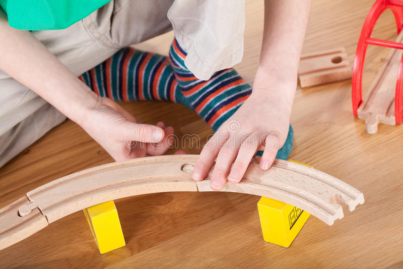 Boy during playing with toys. In playroom stock photography