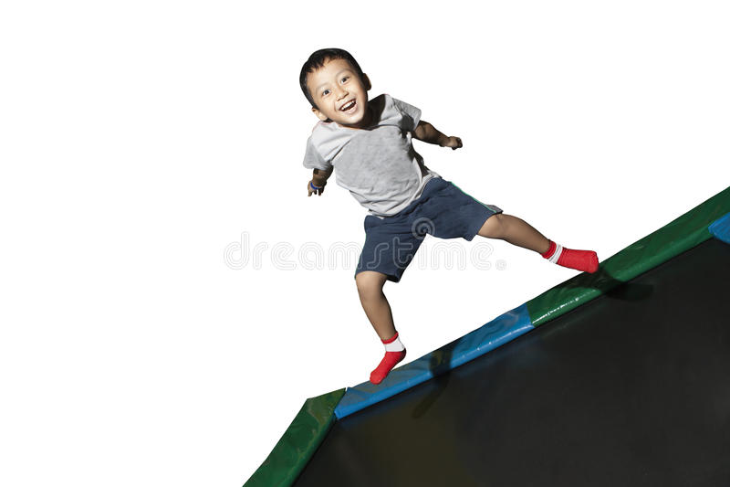 Download Boy Playing On A Trampoline Royalty Free Stock Images - Image: 23051199
