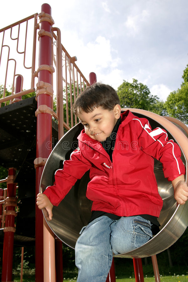 Boy playing in a tube slide