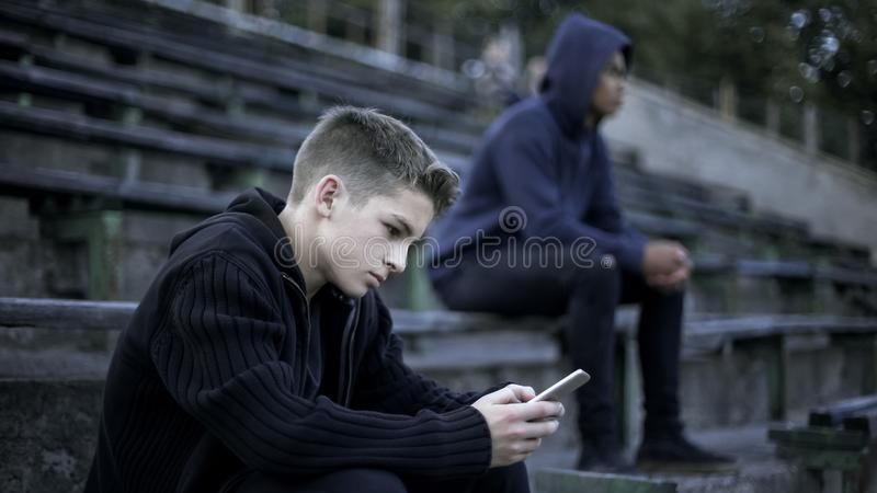Boy playing video game on smartphone, addicted to social network, digital nation. Stock photo stock images