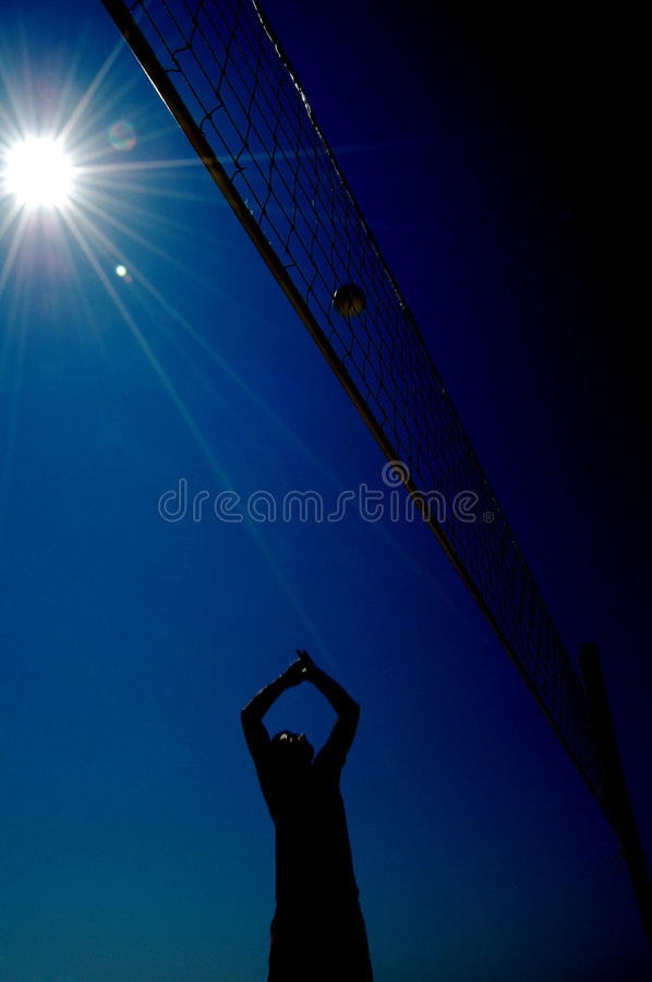 Boy is playing volleyball royalty free stock image