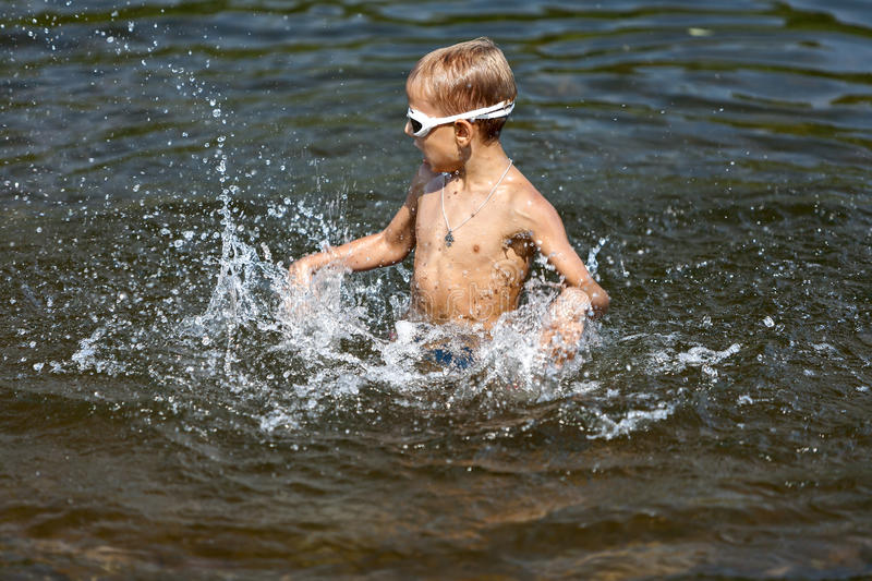 Boy playing in the water (02) stock images