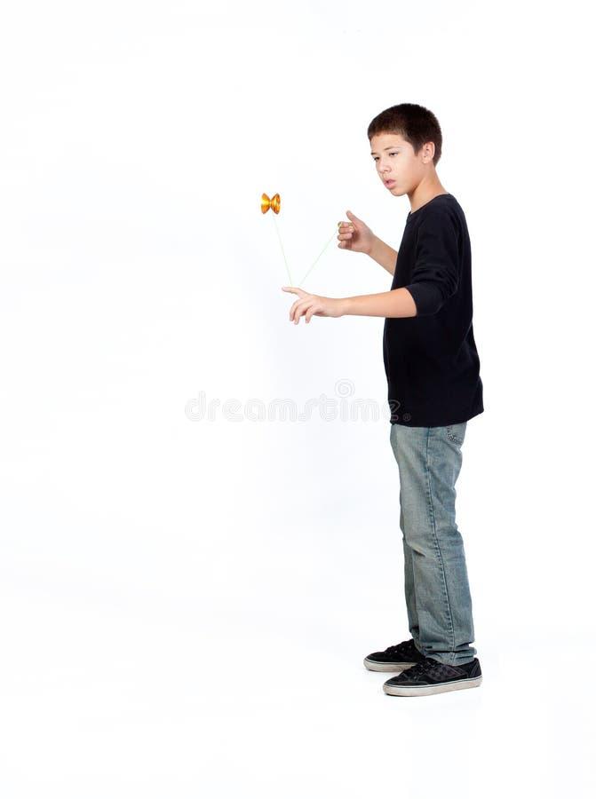 Boy playing yo-yo royalty free stock image