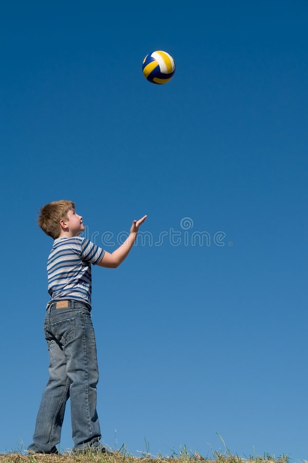 Boy plays a ball