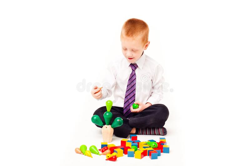 A boy plays with blocks royalty free stock image