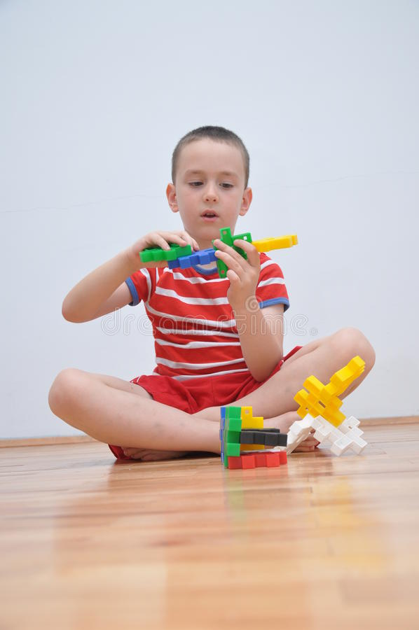 A boy plays with cubes royalty free stock photography