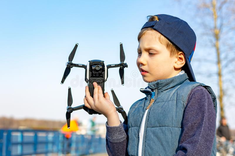 Boy plays with his quadrocopter royalty free stock photos