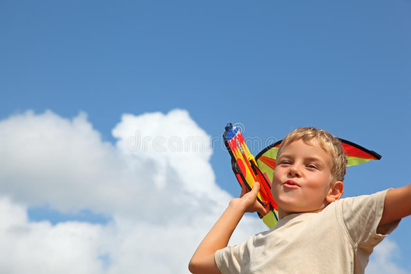Download Boy plays kite against sky stock photo. Image of rocket - 12263480