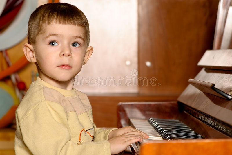 Boy Plays Piano Royalty Free Stock Photography
