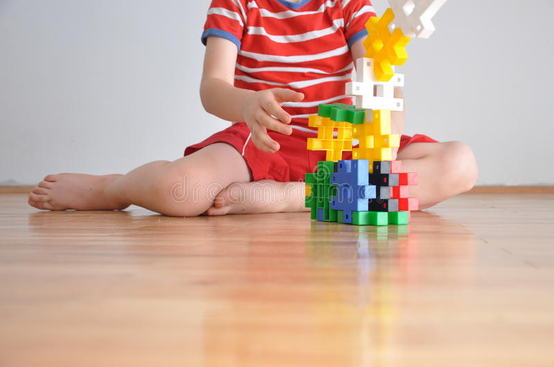 A boy plays with toys cubes royalty free stock images