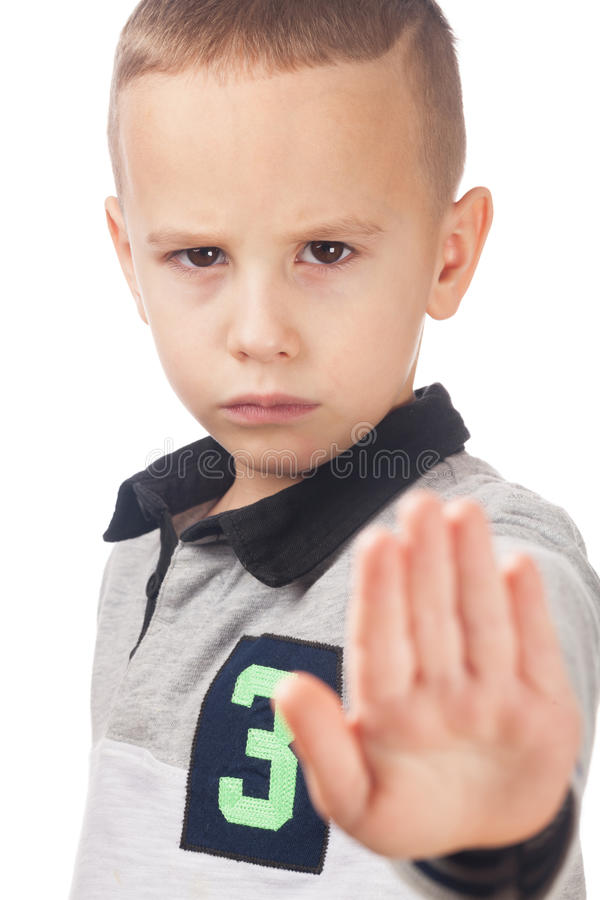 Boy pleasing to stop. Upset boy pleasing to stop on isolated white stock photo