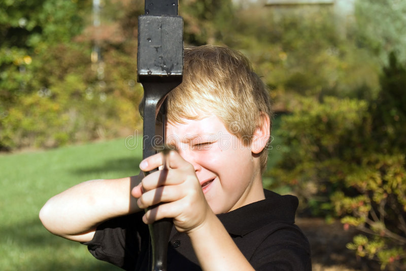 Boy Pointing Arrow. Young boy pointing an arrow, with him in focus stock photos