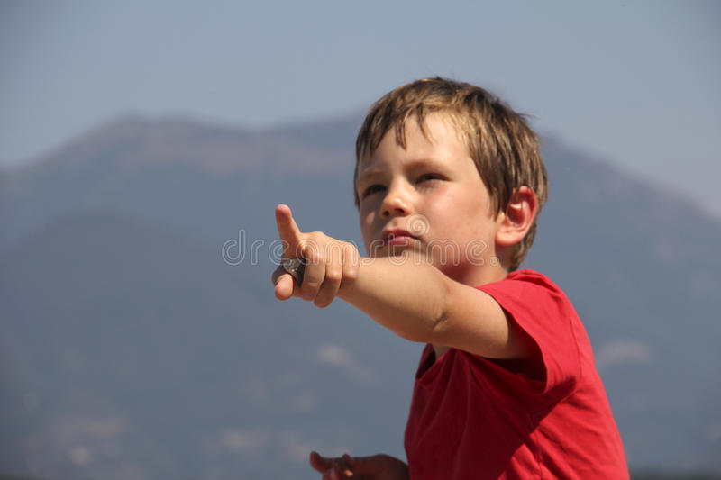 Boy pointing finger stock photography