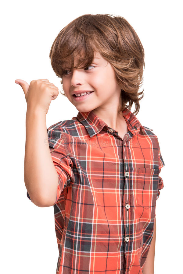 Boy pointing to empty space stock images