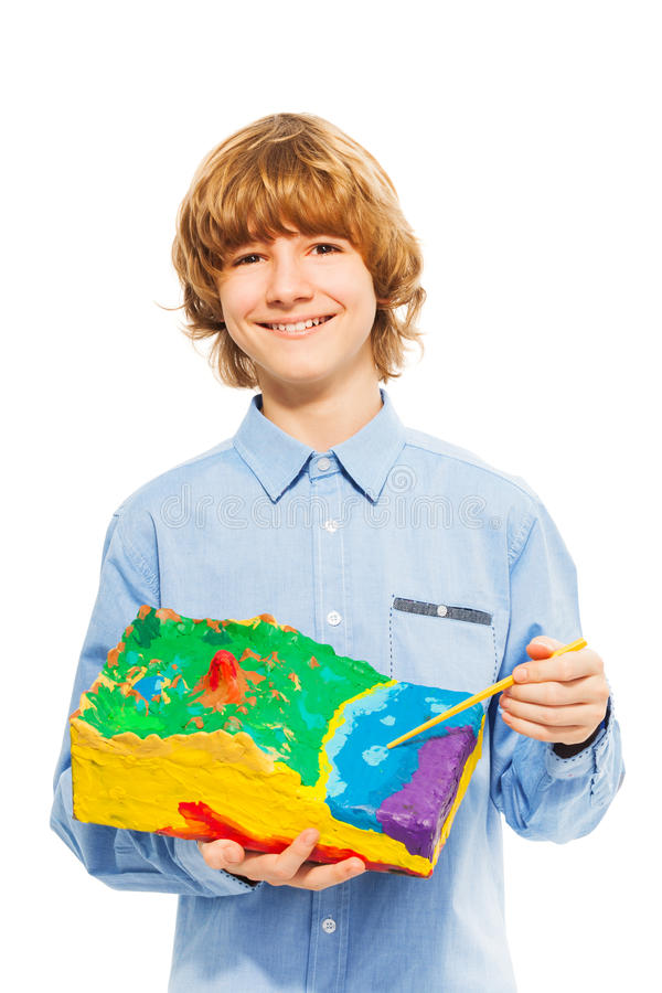 Boy pointing to the water at surface relief model royalty free stock photo