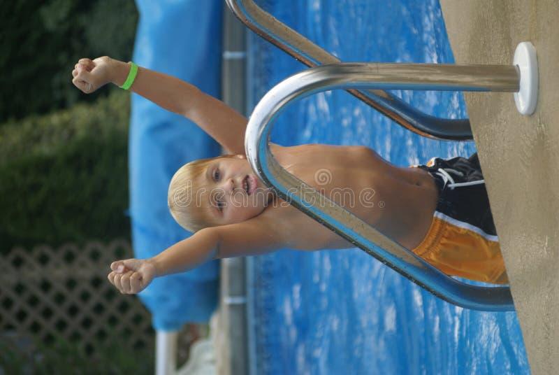 Boy in a pool stock photos