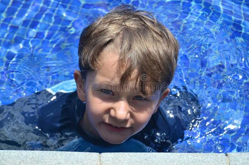 Boy in a pool stock images