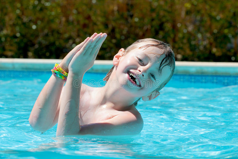 Boy in the pool. Portrait of a happy young boy in the pool