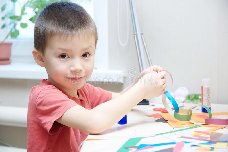 Download Boy Portrait Playing With Paper, Child Crafting Activity Stock Photo - Image: 83720876