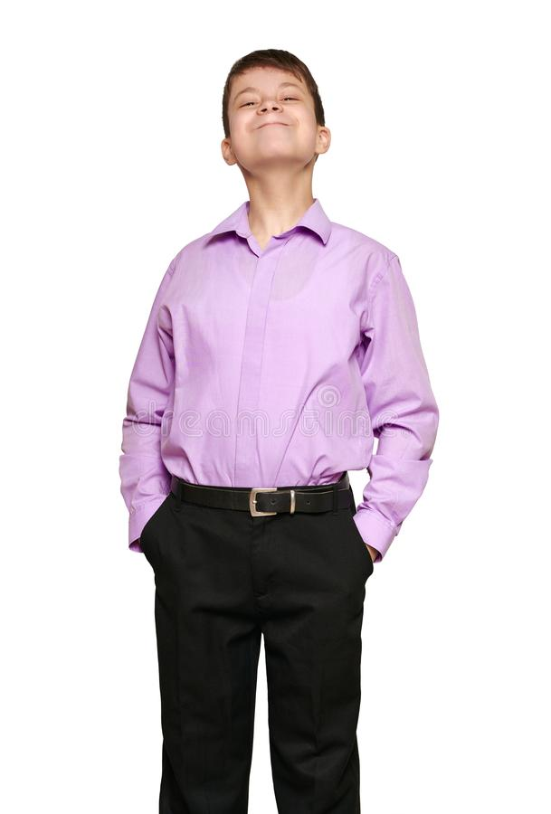 Boy posing on white background, black trousers and purple shirt royalty free stock images