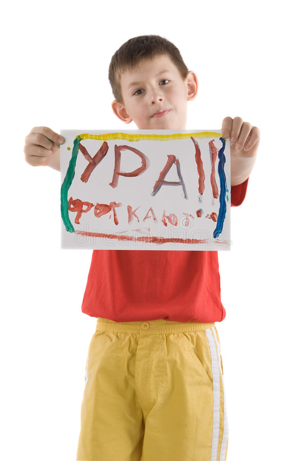 Boy with poster. Boy in red t-shirt and yellow trousers with poster in hands isolated on white stock image