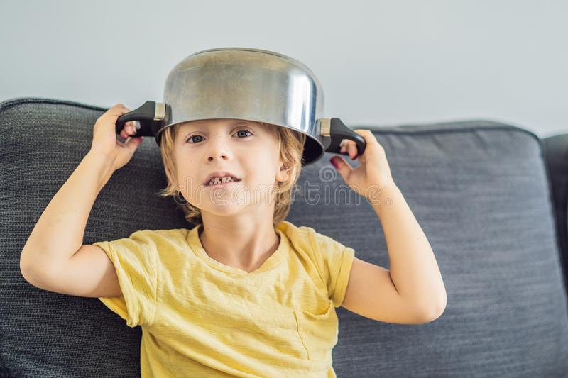 A boy with a pot on his head. Childhood, cook.  stock images