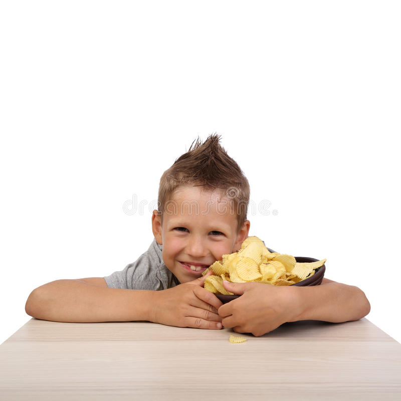 Boy with potatoes chips royalty free stock image