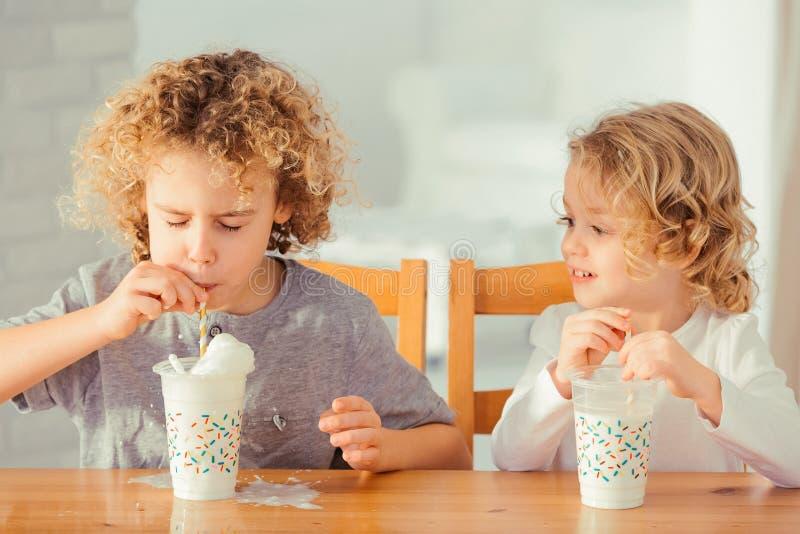 Boy pouring out milk stock photos