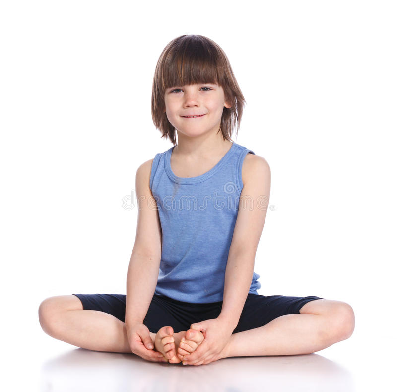 Boy practice yoga. Cute little boy practice yoga. Isolated on the white background royalty free stock photo