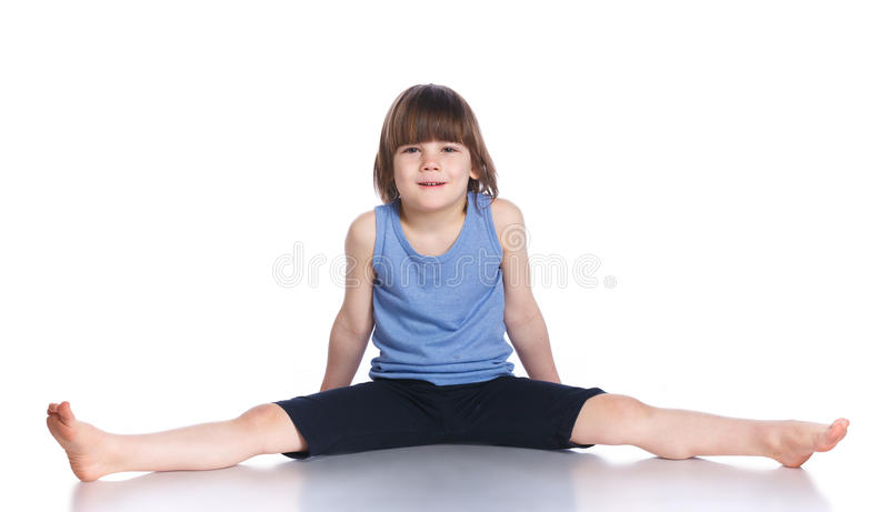 Boy practice yoga. Cute little boy practice yoga. Isolated on the white background stock photos
