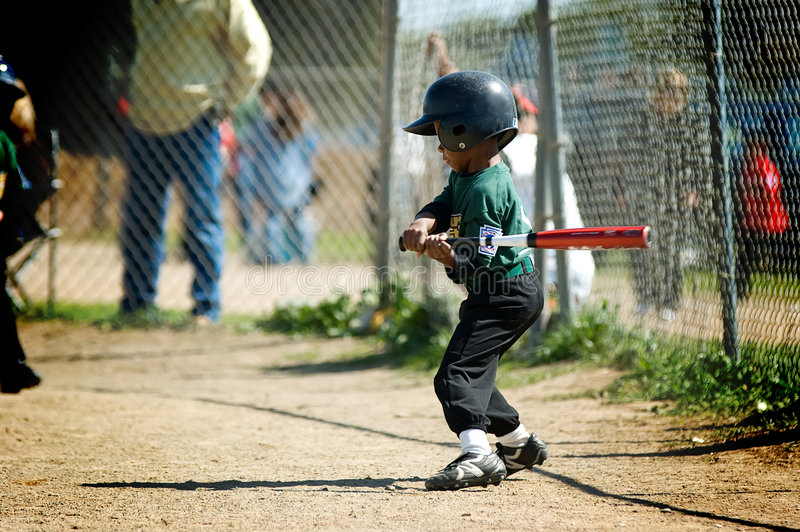 Boy practicing his tball swing stock photos