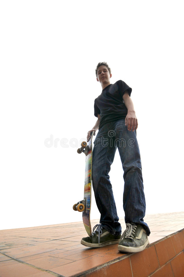 Boy practicing skate in a skate park stock images