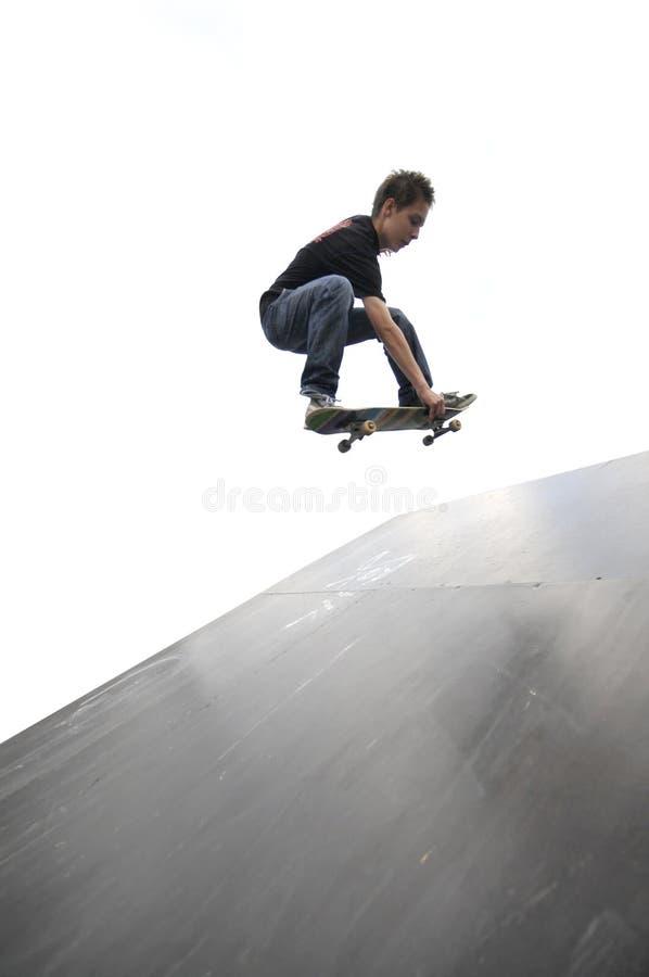 Boy practicing skateboarding royalty free stock photo