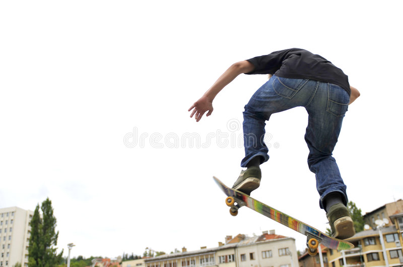 Boy practicing skateboarding royalty free stock images