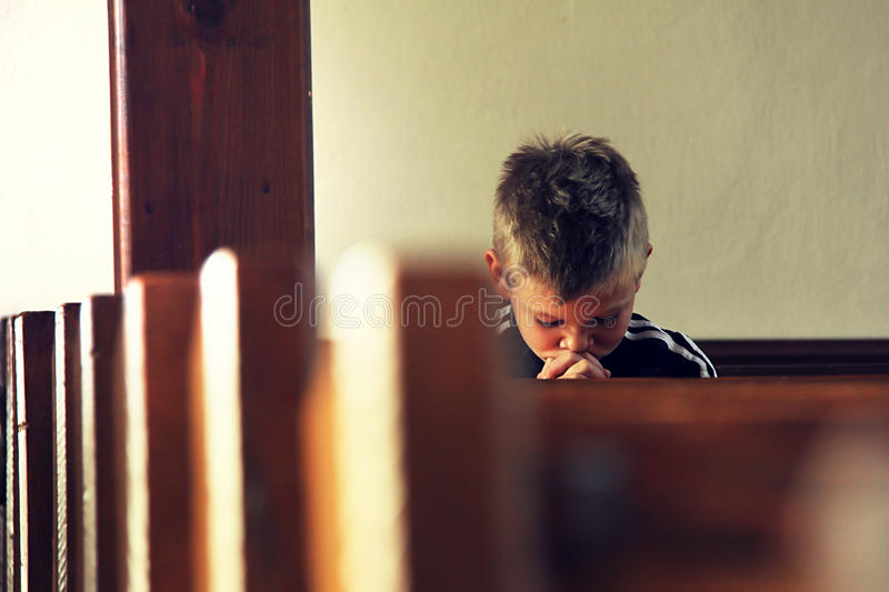 Boy is praying stock photos