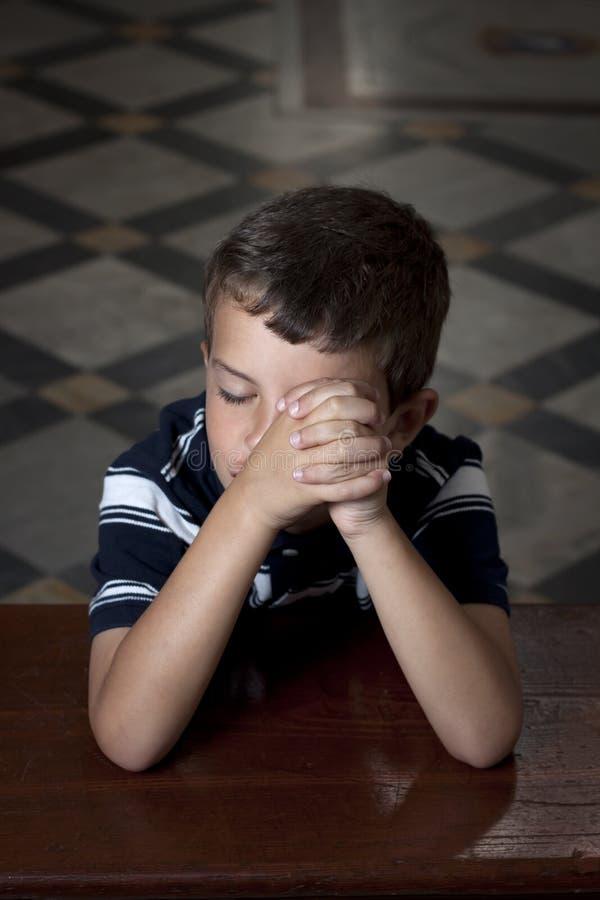 Boy praying stock image