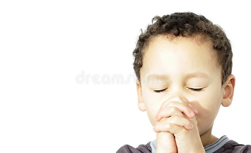 Boy praying with closed eyes stock photo royalty free stock images