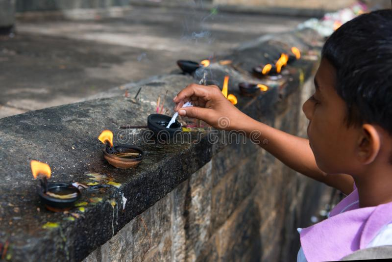 Download Boy Prepares Oil Lamp To Set Fire It In An Offerings Place Of Th Editorial Stock Image - Image of faith, flame: 108136694