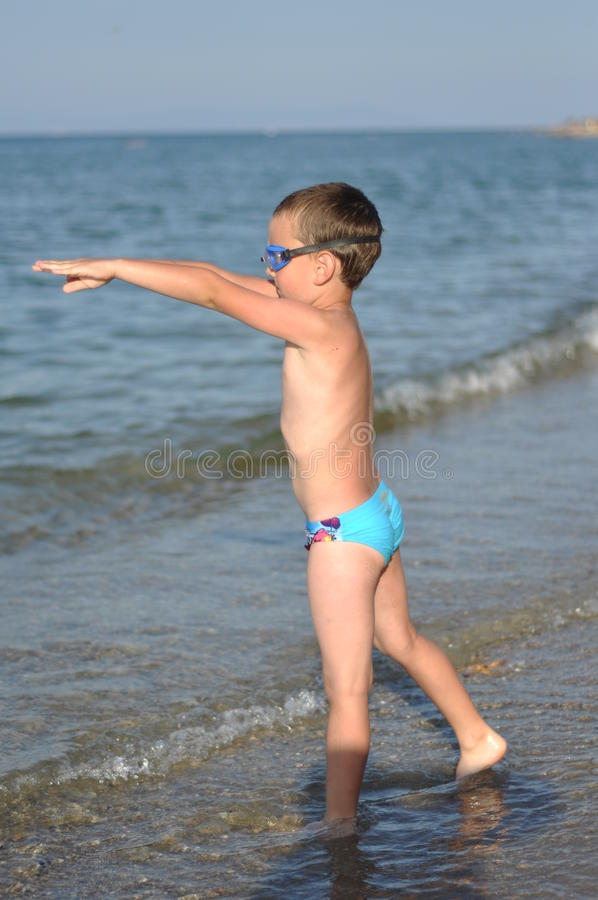 A boy prepares to dive royalty free stock images