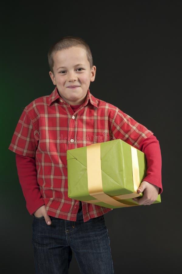 Download Boy present on dark green stock image. Image of surprised - 27708041