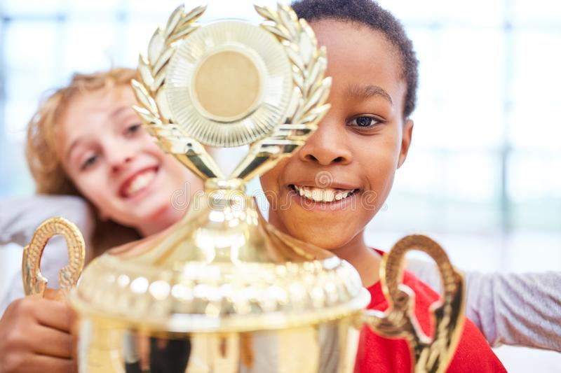 Boy proudly shows the winner cup royalty free stock photography