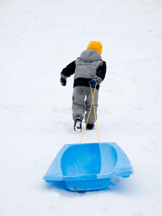 Download Boy pulling sled stock photo. Image of sled, blue, sledding - 8756844