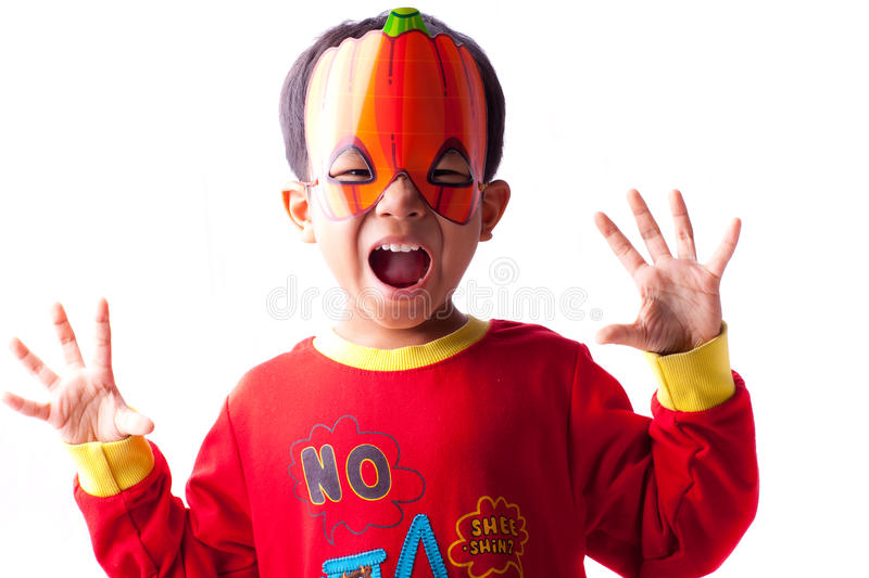 Download Boy in pumpkin mask stock photo. Image of open, background - 27425602