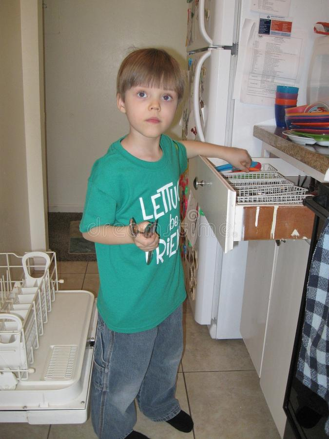 Download Boy Putting Away Silverware Stock Photo - Image of tshirt, inside: 107630774