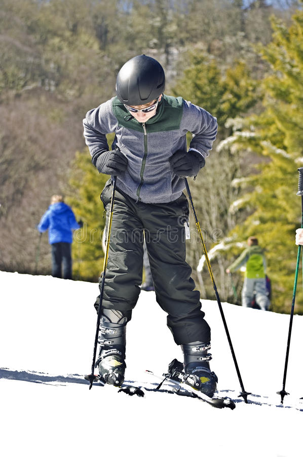 Download Boy Putting on Skis stock image. Image of snow, recreational - 23528577