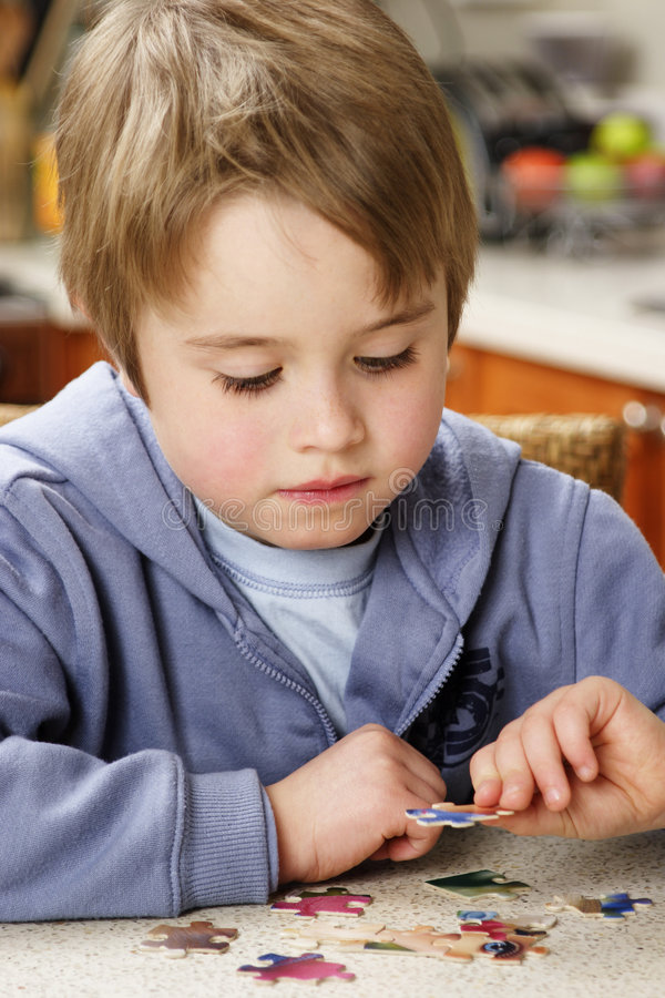 Boy puzzle royalty free stock photo