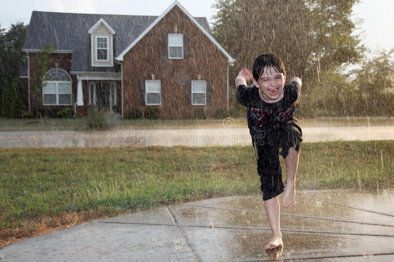 Boy in the Rain royalty free stock photos